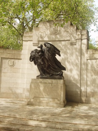 Photograph showing the Belgian War memorial at Victoria Embankment. The memorial consists of a statue and engraved stone.
