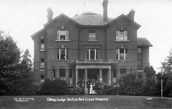 Blcak and white image of staff standing outside Abbey Lodge whilst it was used as a VAD hospital