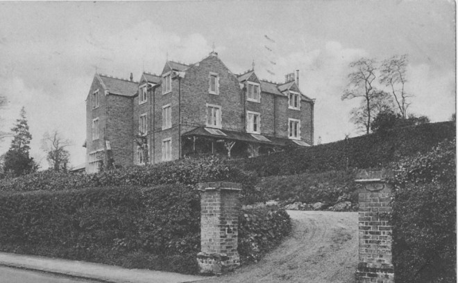 Black and white photograph showing Coed Bel house
