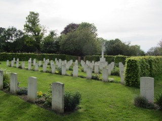 Colour photograph showing rows of headstones in the 'Canadian Corner'