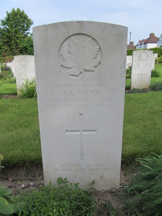 Colour photograph showing the headstone of a Canadian soldier. Engraved into the headstone is a maple leaf.