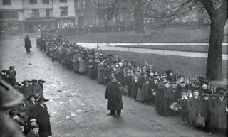 Black and white photograph showing a queue of people. | West Country Studies Library