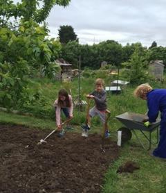 Volunteers digging the allotment plot.   Southlands Road Allotment and Gardens Association